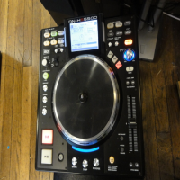 Professional DJ controller/player with internal 500Gb drive. Also supports multiple external USB mass storage devices via USB 2.0, supports MP3 and WAV formats. Tactile jog platter, 2 sets of RCA outputs, enables simultaneous playback of two tracks. Flip between modes to control either track. vgc.