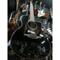 <p>Gorgeous solid top electro by Lag.  Black high gloss finish.</p>