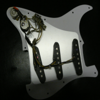 <p>USA strat pickguard loaded with a set of Custom fat 50s, push/push pot, humbucking and other tonal possibilities.</p><p>Pretty much mint condition.</p>