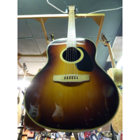 Early-mid '80s roundback acoustic guitar with a lovely warm tone and great playability.  Very good condition for its age.