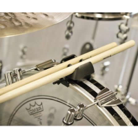 Drumstick holder that provides easy access and quick release.  Especially good for drummers who accidentally drop a stick during a performance!