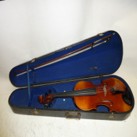 <p>A very playable instrument, loud and resonant with a lovely tone. Slim fingerboard. There is an old, small repair to the bout.  Very good condition considering it's age.</p><p></p>